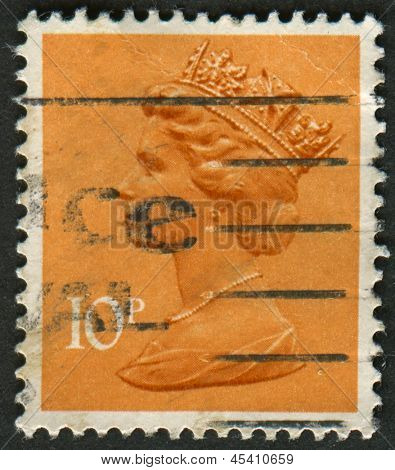 UK-CIRCA 1993:A stamp printed in UK shows image of Elizabeth II is the constitutional monarch of 16 sovereign states known as the Commonwealth realms, in dull orange, circa 1993.
