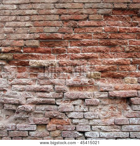 High resolution concept or conceptual old vintage brick wall background pattern.A textured surface of aged brickwork