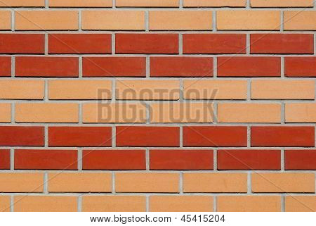 Wall of yellow-red brick.