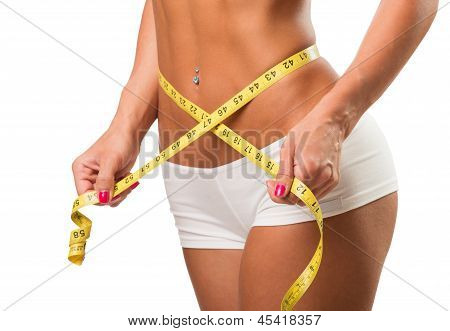 Healthy female body with measuring tape