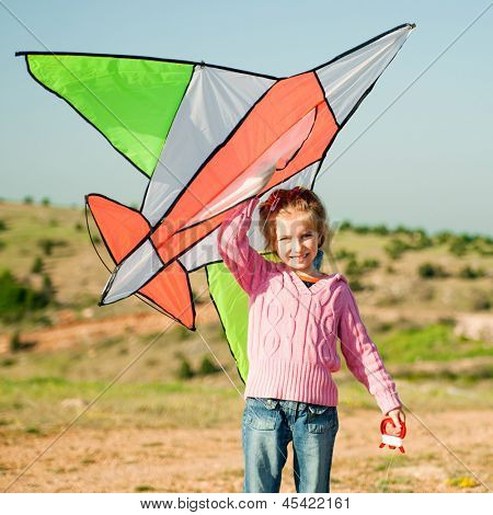 cute little girl flies a kite