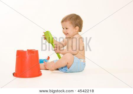 Joyful Baby Playing With Beach Toys