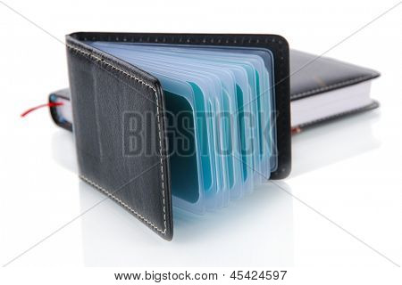 Black business card holder notebook and pen isolated on white