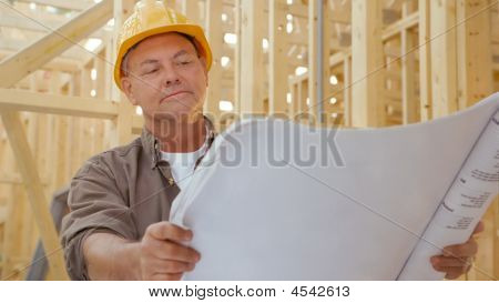 Contractor With Blueprints