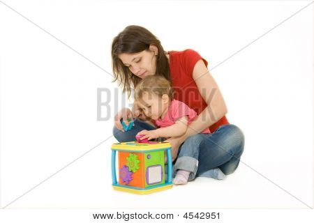 Nice Looking Mother And Baby Playing With Activity Cube