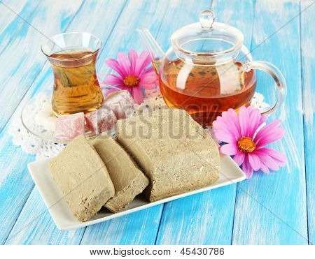Tasty halva with tea on table