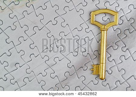 Concept Picture Golden Key To The Puzzle. Close-up.