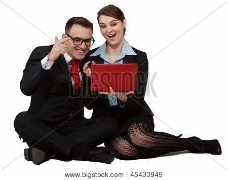 Happy Young Couple On Laptops