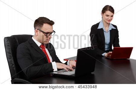 Young Business Couple On Laptops