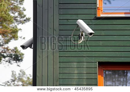 Security Cameras On The Building Walls