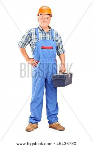Full length portrait of a confident manual worker holding a toolbox isolated on white background