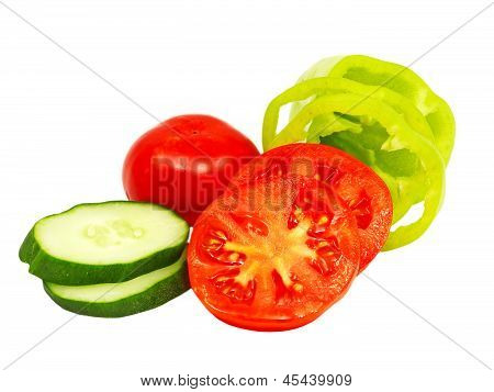 Ripe Sliced Cucumber, Pepper And Tomatoes.isolated.