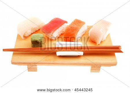 Japanese traditional cuisine - Different Types of Nigiri Sushi : Tuna (maguro) Salmon (sake) and Eel (unagi) with Wasabi  and chopstick on wooden plate isolated over white background