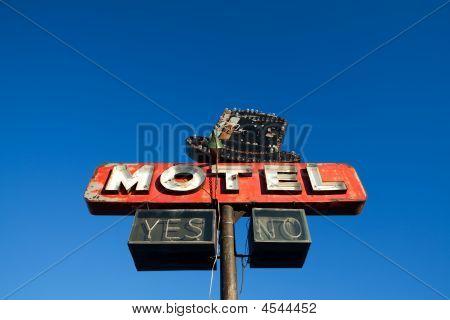 Motel Sign Against Blue Sky