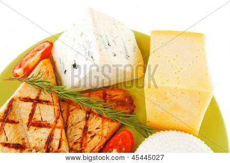 dry hot cheeses and pink roast salmon on green