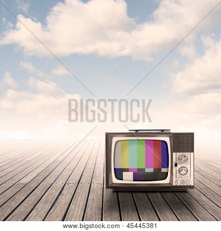 retro portable television on pier with sky on sunset