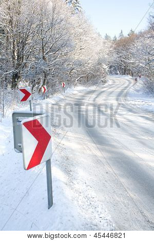 Winter Road With Red Direction Arrows