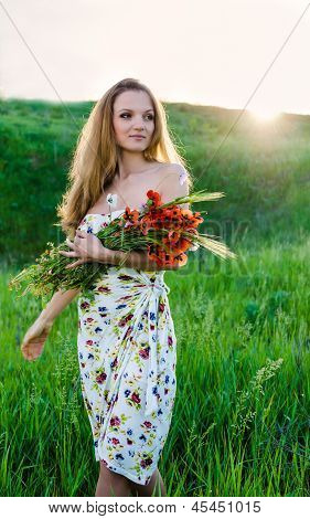 young Woman holding  poppy bouquet