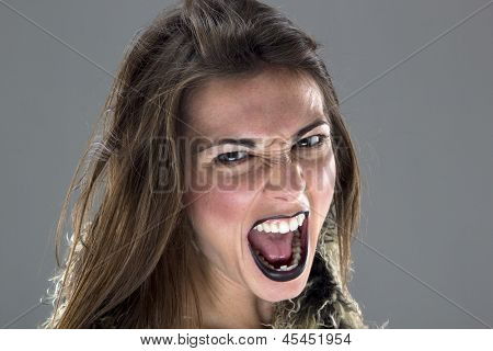Vampire agressive woman over gray background