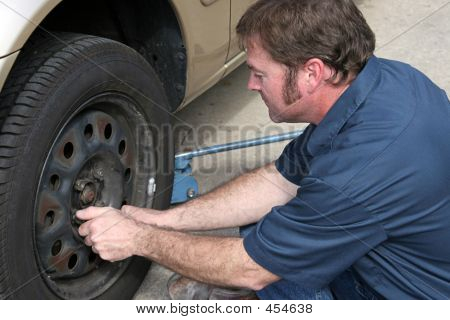 Mechanic Removing Lug Nuts