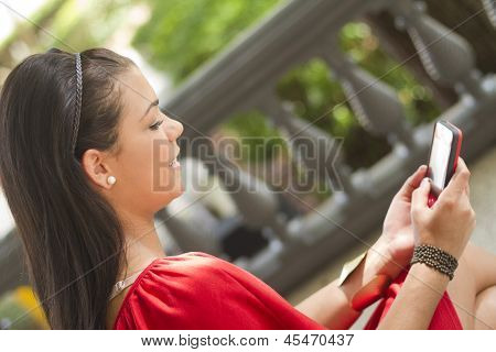 Girl Using Her Mobile Phone To Text Message