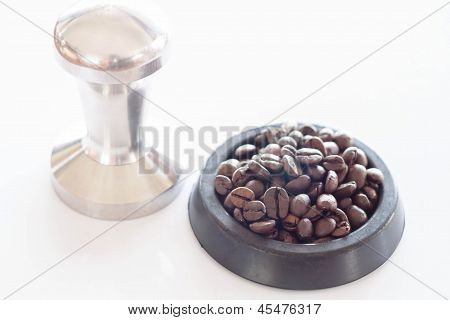 Roasted Coffee In Rubber Saucer And Tamper