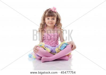 Image of cute little girl posing in candy costume