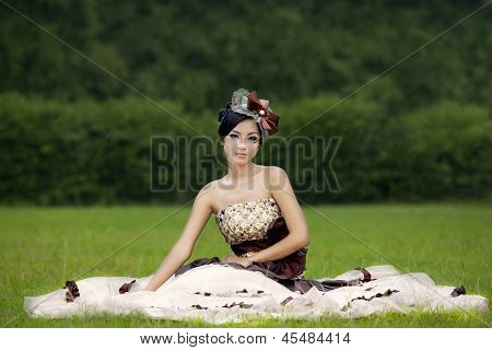 Attractive Lady In Formal Gown At Park