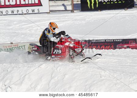 Red And Black Polaris Snowmobile During Race