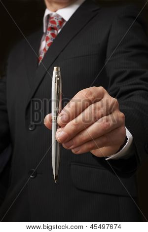 Businessman Holding Pen