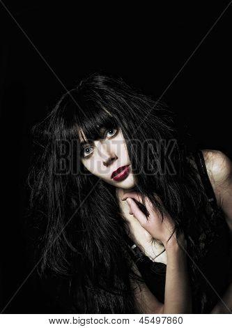 Closeup Portrait Of Beautiful Goth Girl Among The Dark