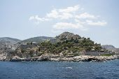stock photo of hydra  - Blue sky and water of mediterranean sea in the harbour of Hydra island - JPG