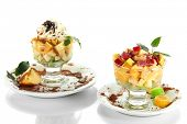 Fruit salad in a sundae dish isolated on whit