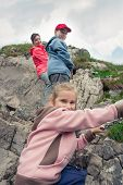 stock photo of mountain chain  - Family hiking in mountains - JPG