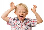 stock photo of mischief  - A angry hyperactive young boy screaming - JPG