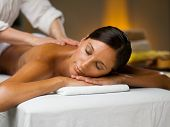foto of low-necked  - Young woman on a massage - JPG