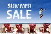stock photo of japanese woman  - Woman jumping over beach chairs with summer sale cloud - JPG