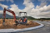 picture of earth-mover  - a digger in a new development area constructing road - JPG