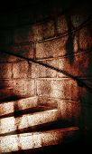 stock photo of stepping stones  - Dirty Stone Steps leading to a dungeon - JPG