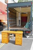 stock photo of rear-end  - Open rear end of moving furniture truck - JPG