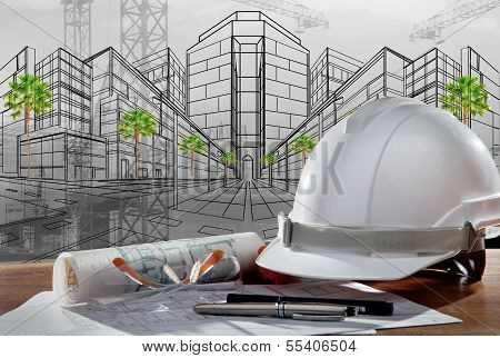 Safety Helmet And Architect Pland On Wood Table With Sunset Scene And Building Construction
