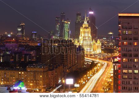 MOSCOW - MAY 12: New Arbat Street, Hotel Ukraine and Business complex Moscow-City at night, on May 12, 2013 in Moscow, Russia. Length of New Arbat is 1.5 km.