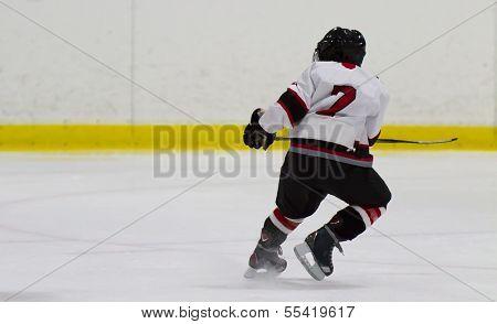 Child Playing Ice Hockey