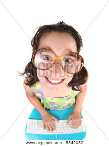 Nerdy Kid Using Computer Looking Up Smiling
