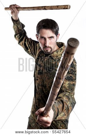 Self Defense Instructor With Bamboo Sticks