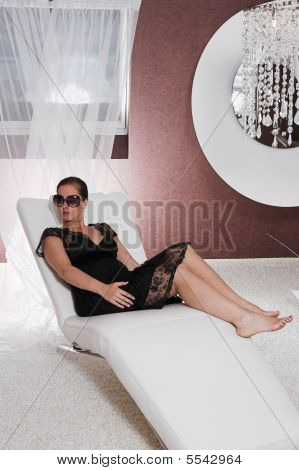 Young Attractive Woman Posing On Couch
