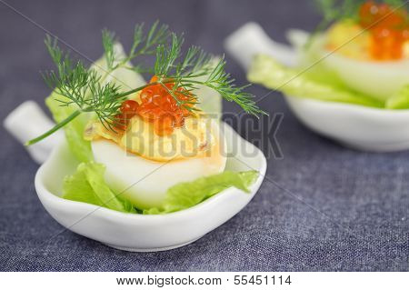 Staffed Egg Appetizer With Red Caviar Garnish And Dill Decoration