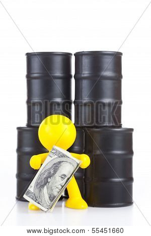 Toy  Little Man Stand At Butts With Oil And Holds Many Money. The World Supremacy Concept Oil-extrac