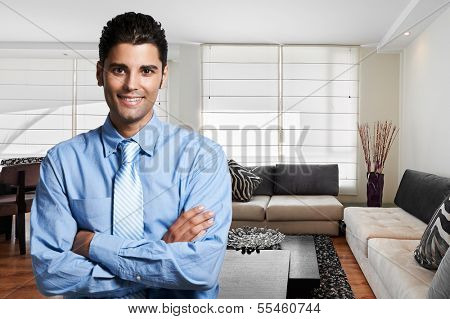 Young successful business man at home