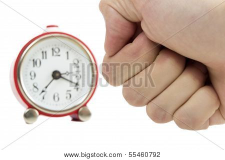 Man's Hand In A Fist About To Hit A Red Clock